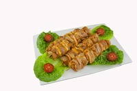 Chicken thigh kebab with bacon